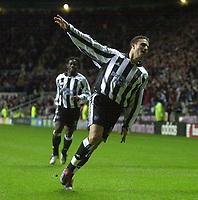 Photo. Glyn Thomas.Digitalsport<br /> Newcastle United v Tottenham Hotspur. FA Barclaycard Premiership. St James' Park, Newcastle. 13/12/2003.<br /> Newcastle's Laurent Robert celebrates scoring his second spectacular goal of the match while Titus Bramble (L) shares his joy.