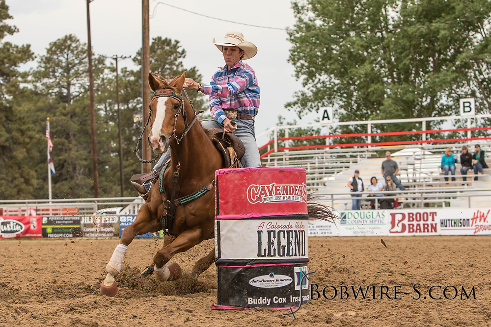 Grace Ann Walker makes her barrel racing run during slack at the Elizabeth Stampede on Sunday, June 3, 2018.
