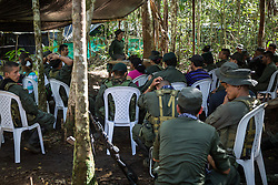 El Diamante, Meta, Colombia - 15.09.2016        <br /> <br /> Guerilla meeting during the 10th conference of the marxist FARC-EP in El Diamante, a Guerilla controlled area in the Colombian district Meta. Few days ahead of the peace contract passing after 52 years of war with the Colombian Governement wants the FARC decide on the 7-days long conferce their transformation into a unarmed political organization. <br /> <br /> Guerilla-Treffen bei der zehnten Konferenz der marxistischen FARC-EP in El Diamante, einem von der Guerilla kontrollierten Gebiet im kolumbianischen Region Meta. Wenige Tage vor der geplanten Verabschiedung eines Friedensvertrags nach 52 Jahren Krieg mit der kolumbianischen Regierung will die FARC auf ihrer sieben taegigen Konferenz die Umwandlung in eine unbewaffneten politischen Organisation beschlieflen. <br />  <br /> Photo: Bjoern Kietzmann