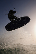 Kitesurfing at sun set in the Mediterranean sea Photographed from within the water