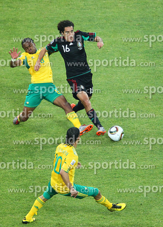 South Africa's Siphiwe Tshabalala vs Mexico's Efrain Juarez  during the Group A first round 2010 FIFA World Cup South Africa match between South Africa and Mexico at Soccer City Stadium on June 11, 2010 in Johannesburg, South Africa.  (Photo by Vid Ponikvar / Sportida)