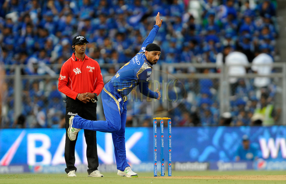 Harbhajan Singh of Mumbai Indians bowls during match 23 of the Pepsi IPL 2015 (Indian Premier League) between The Mumbai Indians and The Sunrisers Hyferabad held at the Wankhede Stadium in Mumbai India on the 25th April 2015.<br /> <br /> Photo by:  Pal Pillai / SPORTZPICS / IPL