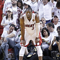 21 June 2012: Miami Heat shooting guard Dwyane Wade (3) rests during the Miami Heat 121-106 victory over the Oklahoma City Thunder, in Game 5 of the 2012 NBA Finals, at the AmericanAirlinesArena, Miami, Florida, USA. The Miami Heat wins the series 4-1.