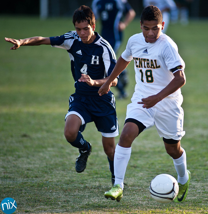 Central Cabarrus' Jonathon Arellano tries to get past Hickory Ridge's Darren Ballesteros Tuesday night at Central Cabarrus High School. (Photo by James Nix)