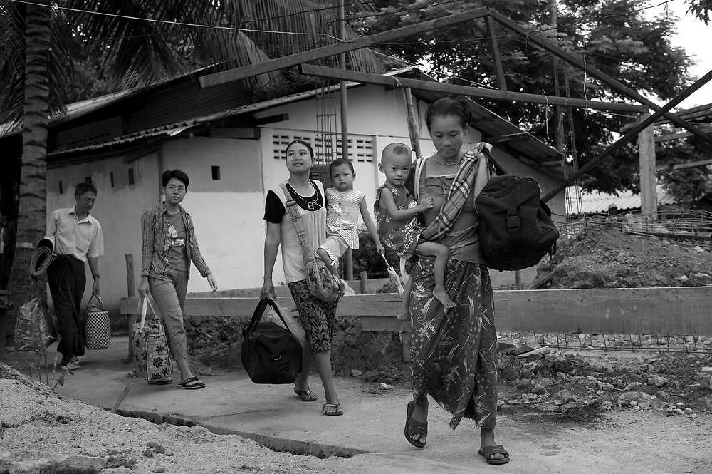 Families who made the trip from Burma to the Mae Tao Clinic in Mae Sot with seriously ill children prepare to travel the extra distance to Chiang Mai Hospital for specialised treatment. The Mae Tao Clinic (MTC), founded and directed by Dr. Cynthia Maung, provides free health care for refugees, migrant workers, and other individuals who cross the border from Burma to Thailand in search of of medical treatment.