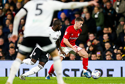 Tommy Rowe of Bristol City is challenged by Aboubakar Kamara of Fulham - Rogan/JMP - 07/12/2019 - Craven Cottage - London, England - Fulham v Bristol City - Sky Bet Championship.