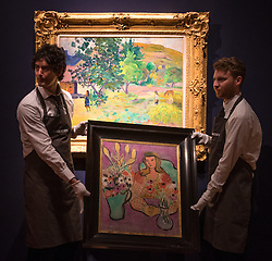 Christie's, London, February 24th 2017. Fine art auctioneers Christie's hold a press preview for their Impressionist and Modern Art and Art of the Surreal sale which takes place on 28th February. PICTURED: Gallery technicians carry Henri Matisse's  Jeune file aux anemones sir fond violet, painted in 1944 and estimated to fetch between £5-7 million. In the background is Paul Gauguin's Te Fare (La maison) painted in 1892, which has an estimate of between £12-18 million.