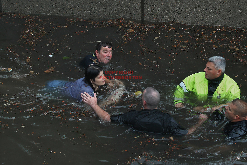 (07/10/10-Somerville,MA) A Somerville firefighter and State troopers rescues a woman from her car under the Mystic Avenue tunnel.Boston Herald Staff photo by Mark Garfinkel