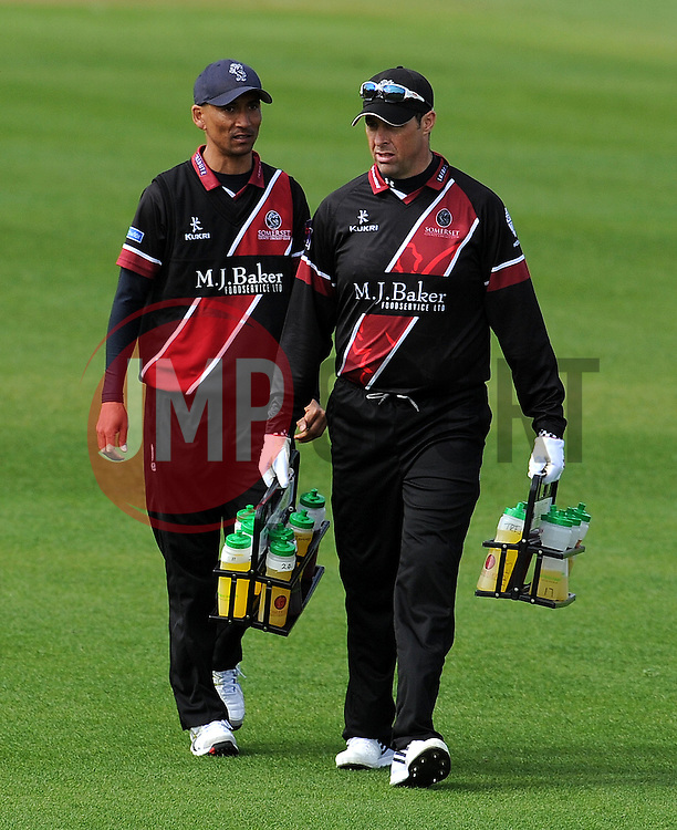 Somerset's Alfonso Thomas and Somerset's Marcus Trescothick- Photo mandatory by-line: Harry Trump/JMP - Mobile: 07966 386802 - 30/03/15 - SPORT - CRICKET - Pre Season Fixture - T20 - Somerset v Gloucestershire - The County Ground, Somerset, England.