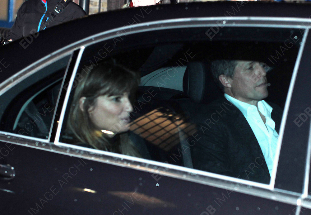 03.OCTOBER.2012. LONDON<br /> <br /> JEMIMA KHAN AND HUGH GRANT LEAVING GWYNETH PALTROW'S 40TH BIRTHDAY PARTY AT THE RIVER CAFE, THAMES WALK IN LONDON.<br /> <br /> BYLINE: EDBIMAGEARCHIVE.CO.UK<br /> <br /> *THIS IMAGE IS STRICTLY FOR UK NEWSPAPERS AND MAGAZINES ONLY*<br /> *FOR WORLD WIDE SALES AND WEB USE PLEASE CONTACT EDBIMAGEARCHIVE - 0208 954 5968*
