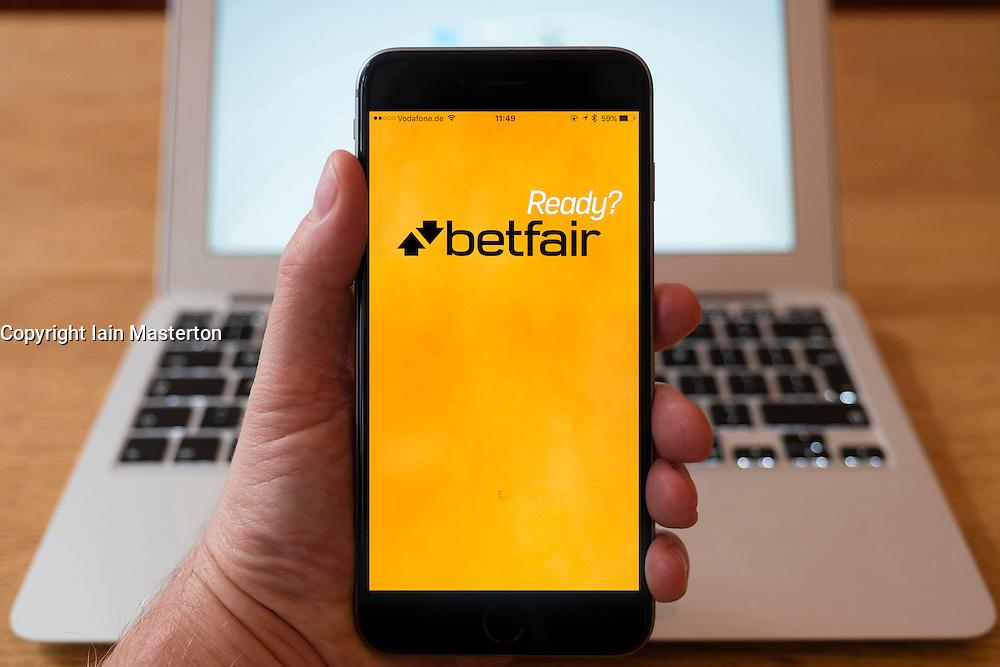 Using iPhone smartphone to display homepage logo of Betfair gambling app