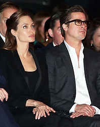 Image licensed to i-Images Picture Agency. 12/06/2014. Brad Pitt and Angelina Jolie listen to the speakers on day three of the End Sexual Violence in Conflict  Global Summit in London Picture by Stephen Lock / i-Images
