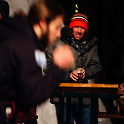 Chris Reed passing a beer to a spectator at the Hostel X team practice.