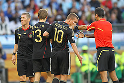 03.07.2010, CAPE TOWN, SOUTH AFRICA, im Bild .Referee Ravshan Irmatov (UZB) tells the German wall of Bastian Schweinsteiger, Thomas Mueller and Lukas Podolski to move back during the Quarter Final, Match 59 of the 2010 FIFA World Cup, Argentina vs Germany held at the Cape Town Stadium..Foto ©  nph /  Kokenge