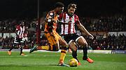 James Tarkowski closes down Chuba Akpom during the Sky Bet Championship match between Brentford and Hull City at Griffin Park, London, England on 3 November 2015. Photo by Michael Hulf.