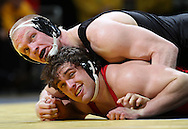 Iowa's Luke Lofthouse and Southern Illinois Edwardsville's Robert Cooney glance up at the clock during the 197-pound bout of their dual at Carver-Hawkeye Arena, 1 Elliot Drive in Iowa City on Friday evening January 7, 2010. Lofthouse pinned Cooney in 3:36 and Iowa defeated Southern Illinois Edwardsville 49-0.