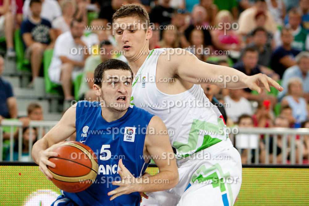 Axel Julien of France and Gezim Morina of Slovenia during basketball match between National teams of Slovenia and France in Quarterfinal Match of U20 Men European Championship Slovenia 2012, on July 20, 2012 in SRC Stozice, Ljubljana, Slovenia. (Photo by Urban Urbanc / Sportida.com)