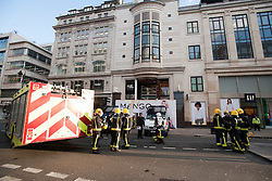 © London News Pictures. 07/03/2012. London, UK.  Police and Fire Brigade outside the Mango Store on Oxford Street, London where the hoarding collapsed injuring 4 people today (07/03/2012) . Photo credit : Ben Cawthra/LNP