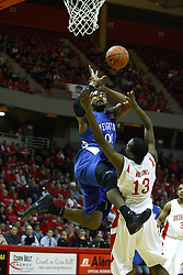 29 December 2010: Gregory Echenique drives the lane against John Wilkins and draws a blocking foul as he shoots during an NCAA basketball game where the Creighton Bluejays defeated the Illinois State Redbirds at Redbird Arena in Normal Illinois.