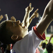 A young Vasco fan celebrates after his side had taken the leader with a goal from Vasco striker Eder Luis during the Vasco V Atletico MG during the Brasileiro  league match as São Januário Stadium. the match ended in a 1-1 draw, Rio de Janeiro, Brazil. 9th September 2010. Photo Tim Clayton