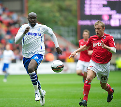 LONDON, ENGLAND - Saturday, October 8, 2011: Tranmere Rovers' Enoch Showunmi and Charlton Athletic's Chris Solly during the Football League One match at The Valley. (Pic by Gareth Davies/Propaganda)