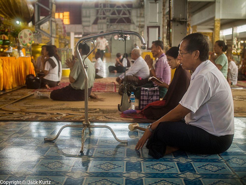 05 JUNE 2014 - YANGON, YANGON REGION, MYANMAR: People pray at Chauktatgyi Paya (pagoda) in Yangon, Myanmar (Rangoon, Burma). Yangon, with a population of over five million, continues to be the country's largest city and the most important commercial center.     PHOTO BY JACK KURTZ