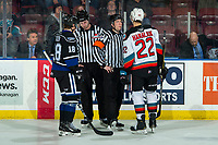 KELOWNA, BC - JANUARY 3: Tarun Fizer #18 of the Victoria Royals and Dillon Hamaliuk #22 of the Kelowna Rockets stand at the officials box with referee Trevor Nolan and line offical Brett Mackey during second period at Prospera Place on January 3, 2020 in Kelowna, Canada. (Photo by Marissa Baecker/Shoot the Breeze)
