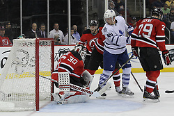 Mar 23; Newark, NJ, USA; Toronto Maple Leafs center David Steckel (20) scores a goal on New Jersey Devils goalie Martin Brodeur (30) during the third period at the Prudential Center. The Maple Leafs defeated the Devils 4-3 in an overtime shootout.