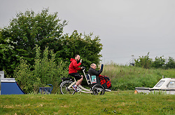 Pictured: Cycling Without Age on the canal towpath at the Kelpies.<br /> <br /> Public health and sport minister Aileen Campbell took to the saddle to launch the Scotland-wide rollout of the Cycling without Age service, designed to get older people out and about.<br /> <br /> © Dave Johnston / EEm