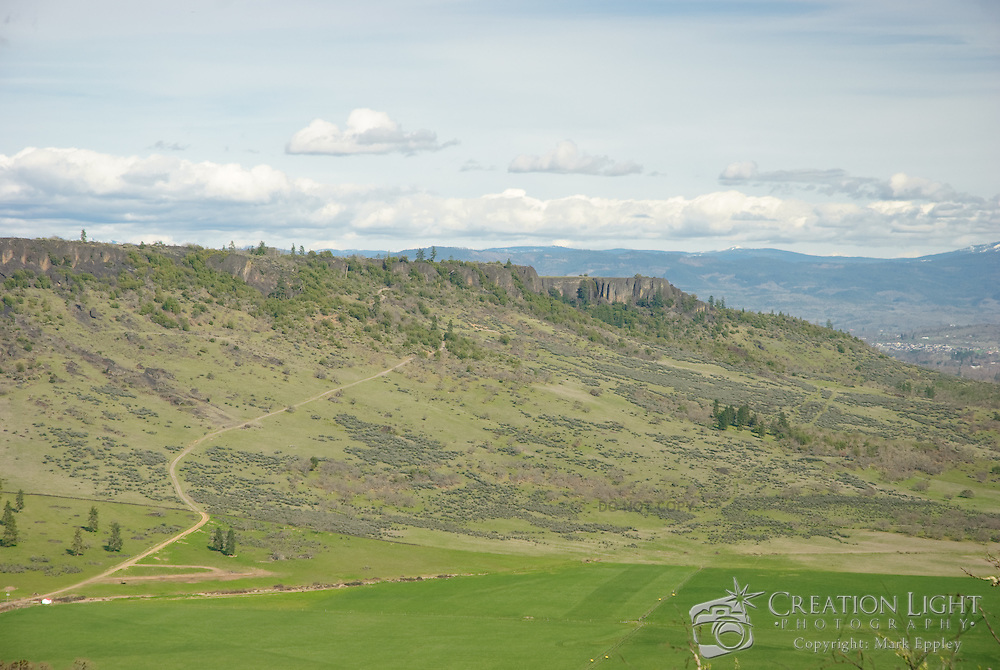 Upper and Lower Table Rock are two prominent volcanic plateaus located just north of the Rogue River in Jackson County, Oregon. Shaped by erosion, they now stand about 800 feet (240 m) above the surrounding Rogue Valley