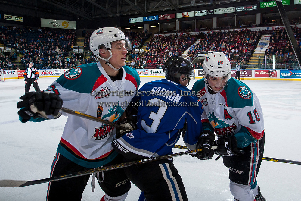 KELOWNA, CANADA - MARCH 7: Calvin Thurkauf #27 and Nick Merkley #10 of the Kelowna Rockets check Ryan Gagnon #3 of the Victoria Royals during first period on March 7, 2017 at Prospera Place in Kelowna, British Columbia, Canada.  (Photo by Marissa Baecker/Shoot the Breeze)  *** Local Caption ***