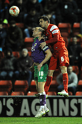 Bristol City's Aaron Wilbraham challenges for the header with Leyton Orient's Mathieu Baudry - Photo mandatory by-line: Dougie Allward/JMP - Mobile: 07966 386802 - 03/03/2015 - SPORT - football - Leyton - Brisbane Road - Leyton Orient v Bristol City - Sky Bet League One