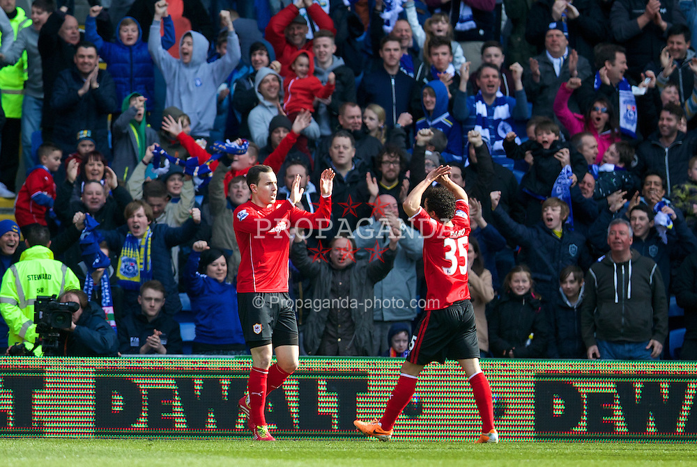 CARDIFF, WALES - Saturday, March 22, 2014: Cardiff City's Jordon Mutch celebrates scoring the first goal against Liverpool during the Premiership match at the Cardiff City Stadium. (Pic by David Rawcliffe/Propaganda)