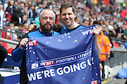 Backroom staff celebate with a we're going up banner after the Sky Bet League 2 play off final match between AFC Wimbledon and Plymouth Argyle at Wembley Stadium, London, England on 30 May 2016.