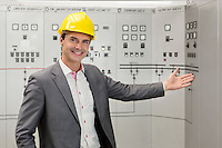 Portrait of young male manager gesturing in control room