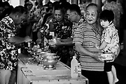The congregation prepares to feed monks during Songkran 2017 festivities in Nakhon Nayok, Thailand. PHOTO BY LEE CRAKER