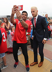 CARDIFF, WALES - Saturday, June 4, 2016: Wales' Aaron Ramsey stops for a selfie as the team are given a colourful send off at Cardiff Airport as the squad head to Sweden for their last friendly before the UEFA Euro 2016 in France. (Pic by David Rawcliffe/Propaganda)