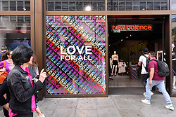 © Licensed to London News Pictures. 01/07/2019. LONDON, UK.  The New Balance store on Oxford Street is one of many retail stores in the capital's West End whose exteriors are decorated in rainbow colours in support of Pride Month.  Pride is an annual celebration of the LGBT+ community and culminates in the LGBT+ parade in the UK, with thousands of people travelling the route either by foot or on floats.  Photo credit: Stephen Chung/LNP
