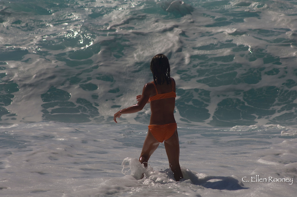 A young girl playing in surf at Myrtos Beach,  Kefalonia, The Ionian Islands, Greece