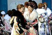 Kimono-clad 20-year-old Japanese women enjoy a beer and cigarette during an event to mark Coming-of-Age Day at Toshimaen amusement park in Tokyo, Japan on Monday Jan. 11, 2009. Japanese enter adulthood at 20, when they can legally smoke, drink alcohol and vote, though debate is heating up as to whether or not the age should be lowered to 18 in line with many advanced countries. Indeed, the Japanese government plans to lower the voting age to 18 as of mid-2010.   .Photographer: Robert GilhoolyKimono-clad 20-year-old Japanese women walk past a store selling hot-dogs as they make their way to an event to mark Coming-of-Age Day in Tokyo, Japan on Monday Jan. 11, 2009. Japanese enter adulthood at 20, when they can legally smoke, drink alcohol and vote, though debate is heating up as to whether or not the age should be lowered to 18 in line with many advanced countries. Indeed, the Japanese government plans to lower the voting age to 18 as of mid-2010.   .Photographer: Robert GilhoolyCOMING OF AGE