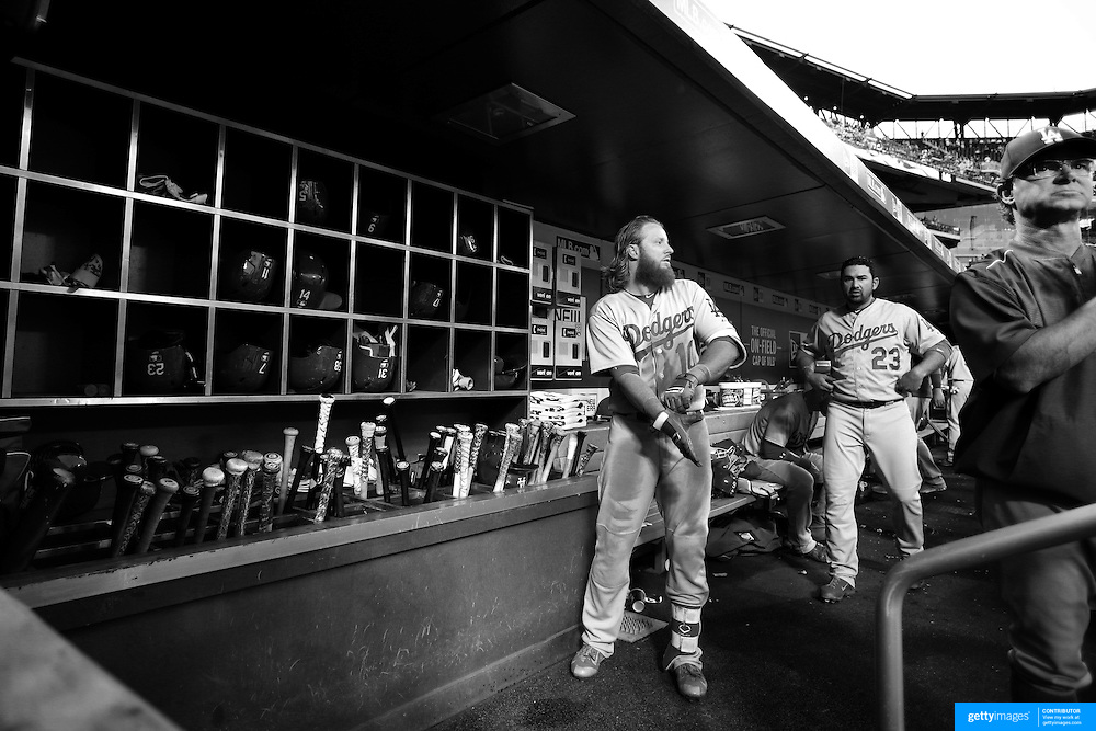 Justin Turner, Los Angeles Dodgers, in the dugout preparing to bat with Manger Don Mattingly, (right), during the New York Mets Vs Los Angeles Dodgers MLB regular season baseball game at Citi Field, Queens, New York. USA. 25th July 2015. Photo Tim Clayton