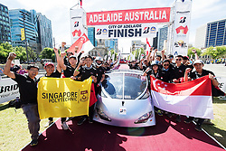 ADELAIDE, AUSTRALIA - OCTOBER 13:  Team members of SunSPEC vehicle 'SunSPEC5' from Singapore celebrate at the finish line on Day 6 of the 2017 Bridgestone World Solar Challenge at Victoria Square on October 13, 2017 in Adelaide, Australia. Teams from across the globe are competing in the 2017 World Solar Challenge - a 3000 km solar-powered vehicle race between Darwin and Adelaide. The race begins on October 8th with the first car expected to cross the finish line on October 11th.  (Photo by Daniel Kalisz/Getty Images for SATC) (Credit Image: © 2017 Bridgestone World Solar C/Xinhua via ZUMA Wire)