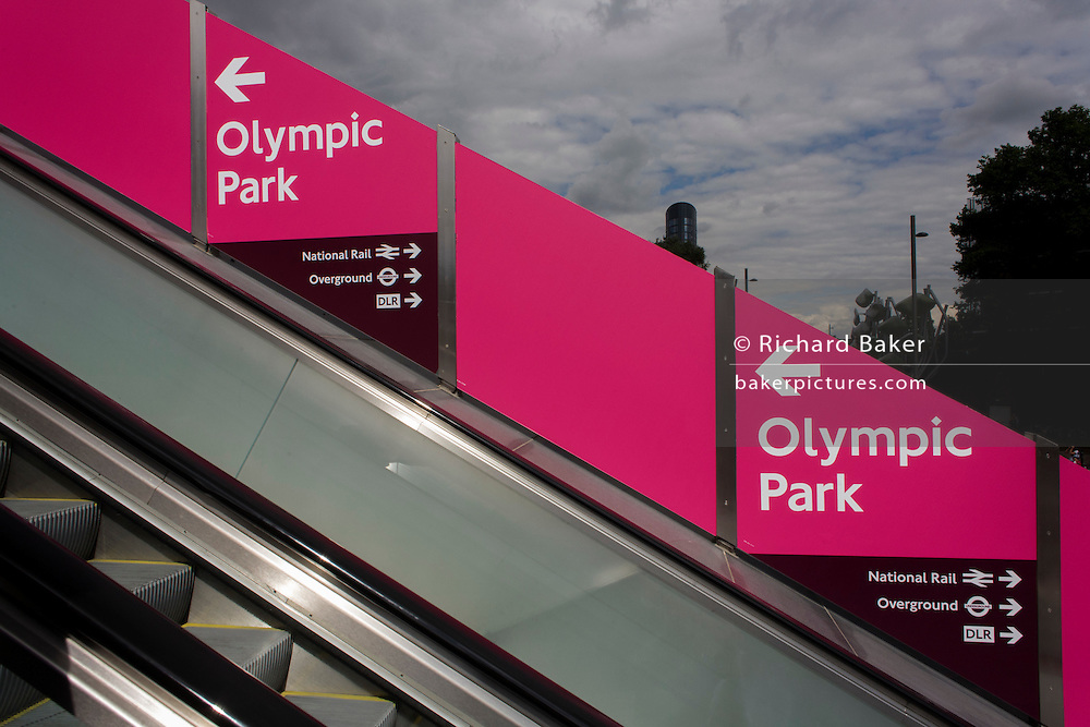 A diagonal landscape of a sign pointing to the Olympic Park at the Westfield mall, during the London 2012 Olympics.