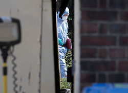 © Licensed to London News Pictures. 24/06/2018. London, UK. Police forensics officers work in the back garden of a house in Greenwich after the body of a woman in her 50s was found in the garden yesterday. Photo credit: Peter Macdiarmid/LNP