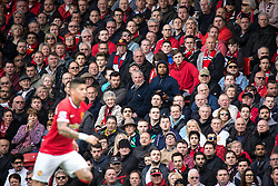 © Licensed to London News Pictures . 17/05/2015 .  Old Trafford , Manchester , UK . Manchester United fans watching the match . Manchester Utd vs Arsenal at Old Trafford Football Stadium , Manchester . Photo credit : Joel Goodman/LNP