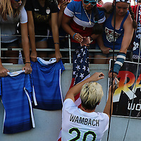 ORLANDO, FL - OCTOBER 25: Abby Wambach #20 of USWNT signs autographs for fans after a women's international friendly soccer match between Brazil and the United States at the Orlando Citrus Bowl on October 25, 2015 in Orlando, Florida. (Photo by Alex Menendez/Getty Images) *** Local Caption *** Abby Wambach