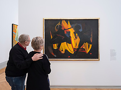 Visitor looking at painting, Children Playing With Fire by Rufino Tamayo at new Museum Barberini in Potsdam Germany