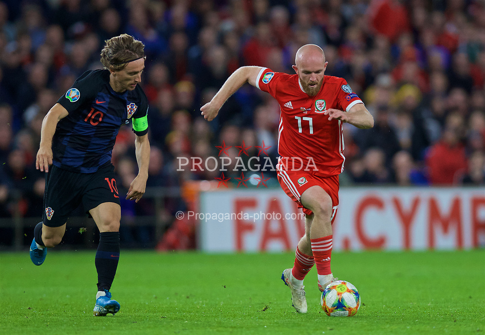 CARDIFF, WALES - Sunday, October 13, 2019: Croatia's captain Luka Modrić (L) chases Wales' Jonathan Williams during the UEFA Euro 2020 Qualifying Group E match between Wales and Croatia at the Cardiff City Stadium. (Pic by Laura Malkin/Propaganda)