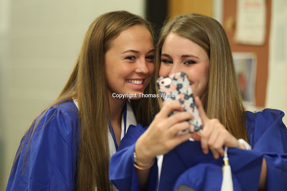 """Madison Hogue, left, and Haley McGill geta quick """"Selfie"""" before getting in line for Saturday's Saltillo Graduation."""