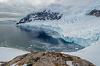 Snow covered landscape and glacier at Neko Harbor on the Antarctic Peninsula.